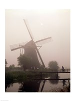 Windmill and Cyclist, Zaanse Schans, Netherlands black and white Fine-Art Print