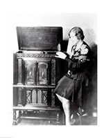 Young woman sitting beside an RCA Radio-Phonograph and Home Recorder Fine-Art Print