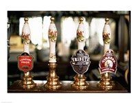 Close-up of beer tap handles in a bar, London, England Fine-Art Print