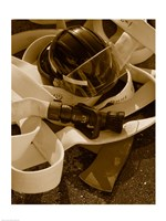 Close-up of a firefighter's helmet on a fire hose Fine-Art Print