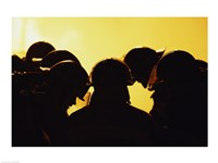Rear view of a group of firefighters looking down Fine-Art Print