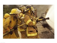 Side profile of a group of firefighters holding water hoses Fine-Art Print