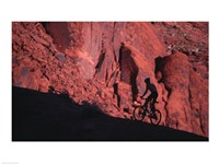 Silhouette of a man mountain biking, Moab, Utah, USA Fine-Art Print