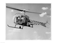 Low angle view of two people sitting in a helicopter, Bell 47G-2 Fine-Art Print