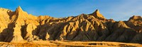 Sculpted sandstone spires in golden light, Saddle Pass Trail, Badlands National Park, South Dakota, USA Fine-Art Print
