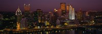 High angle view of buildings lit up at night, Pittsburgh, Pennsylvania, USA Fine-Art Print