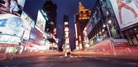 Low angle view of sign boards lit up at night, Times Square, New York City, New York, USA Fine-Art Print