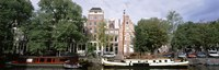 Netherlands, Amsterdam, Boats in canal Fine-Art Print