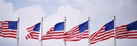 Low angle view of American flags fluttering in wind Fine-Art Print