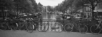 Bicycle Leaning Against A Metal Railing On A Bridge, Amsterdam, Netherlands Fine-Art Print