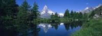 Reflection of a snow covered mountain near a lake, Grindjisee, Matterhorn, Zermatt, Switzerland Fine-Art Print