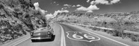 Vintage car moving on Route 66 in black and white, Arizona Fine-Art Print