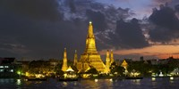 Buddhist temple lit up at dawn, Wat Arun, Chao Phraya River, Bangkok, Thailand Fine-Art Print
