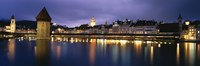 Buildings lit up at dusk, Chapel Bridge, Reuss River, Lucerne, Switzerland Fine-Art Print