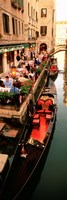Gondolas moored outside of a cafe, Venice, Italy Fine-Art Print