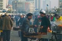 Muslim Chinese Uyghur minority food vendors selling food in a street market, Pudong, Shanghai, China Fine-Art Print