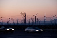 Cars moving on road with wind turbines in background at dusk, Palm Springs, Riverside County, California, USA Fine-Art Print