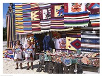 Two female vendors dressed in Mayan costumes displaying products Fine-Art Print