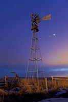 Venus and Jupiter are visible behind an old farm water pump windmill, Alberta, Canada Fine-Art Print