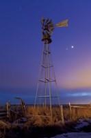 Venus and Jupiter are visible behind an old farm water pump windmill, Alberta, Canada Fine-Art Print