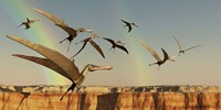 A flock of Pterodactyls fly out of a canyon Fine-Art Print