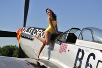 Beautiful 1940's style pin-up girl posing with a P-51 Mustang Fine-Art Print