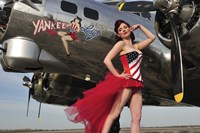 Beautiful 1940's style pin-up girl standing under a B-17 bomber Fine-Art Print