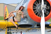 1940's style pin-up girl posing on a T-6 aircraft Fine-Art Print