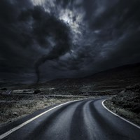 Tornado near a winding road in the mountains, Crete, Greece Fine-Art Print