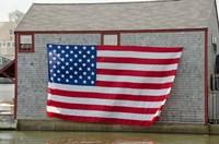 Massachusetts, Nantucket, Flag on boathouse Fine-Art Print