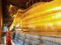 Praying the reclined Buddha, Wat Pho, Bangkok, Thailand Fine-Art Print