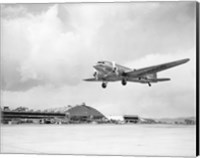 Low angle view of a military airplane landing, Douglas DC-3 Fine-Art Print