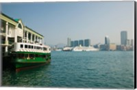 Star ferry on a pier with buildings in the background, Central District, Hong Kong Island, Hong Kong Fine-Art Print