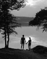 Man And Woman In Bathing Suits Holding Hands Watching Sunset Lakeside Fine-Art Print