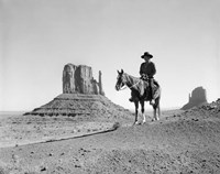 Navajo Indian In Cowboy Hat On Horseback With Monument Valley Rock Formations In Background Fine-Art Print