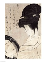 Young woman applying make-up Fine-Art Print