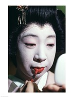 Close-up of a geisha applying lipstick to her lips Fine-Art Print