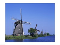 Windmills along a river, Kinderdike, Amsterdam, Netherlands Fine-Art Print