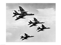Low angle view of four fighter planes flying in formation, F-100 Super Sabre Fine-Art Print