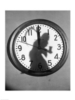 Close-up of the shadow of a person carrying a scythe on a clock Fine-Art Print