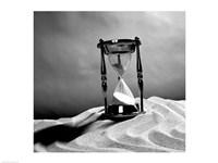 Close up of hourglass on sand Fine-Art Print