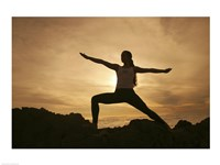 Silhouette of a young woman practicing yoga, Haleakala National Park, Maui, Hawaii, USA Fine-Art Print