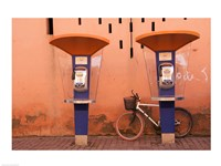 Public telephone booths in front of a wall, Morocco Fine-Art Print