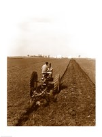USA, Pennsylvania, Farmer on Tractor Plowing Field Fine-Art Print