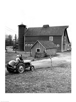 Man with a Boy Riding a Tractor in a Field Fine-Art Print