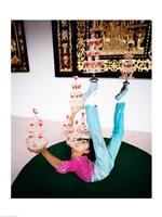 Acrobat balancing glasses, Shanghai, China Fine-Art Print