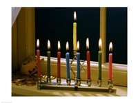 Close-up of a menorah with burning candles and a Star of David Fine-Art Print