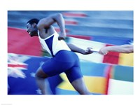 Side profile of runners passing a baton in a relay race Fine-Art Print