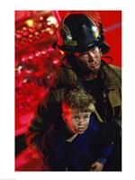 Close-up of a firefighter carrying a boy Fine-Art Print