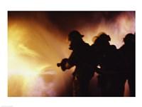 Firefighters extinguishing a fire Fine-Art Print